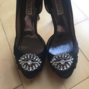 Badgley Mischka Black bejeweled satine pumps.